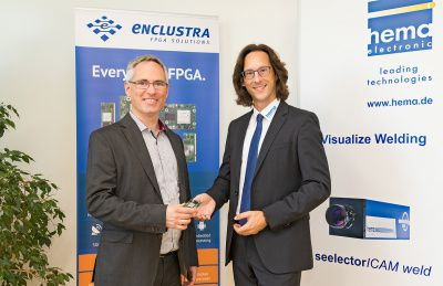 Martin Heimlicher, president and founder Enclustra and Oliver Helzle (right), president hema electronic